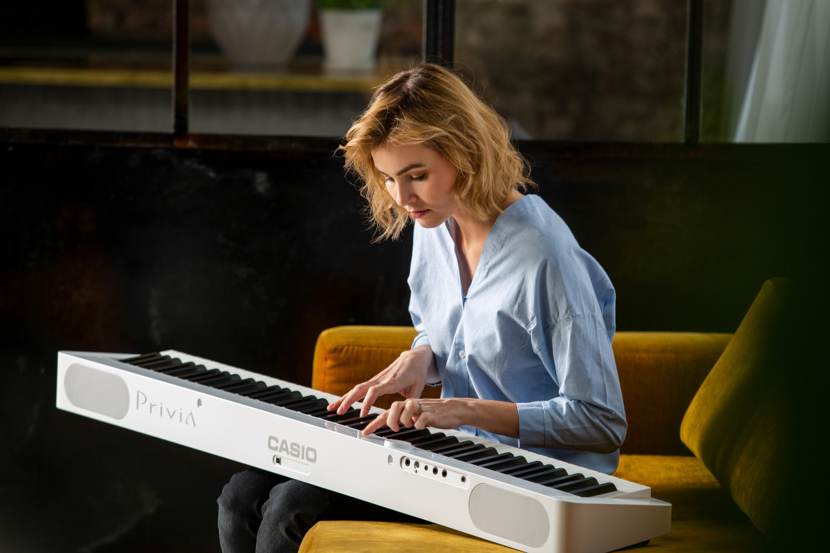 Musician performing on the CASIO Privia PX-S1000 keyboard